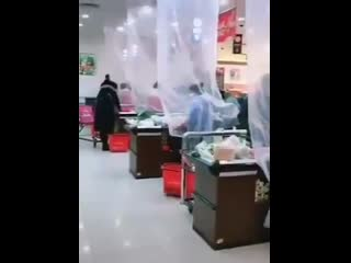 Welcome to the new normal. - - Super market cashiers scanning items
