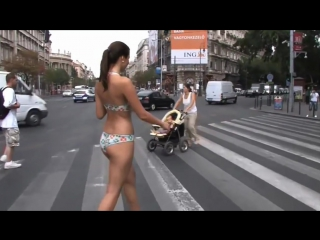 Sexxy woman almost naked on the street
