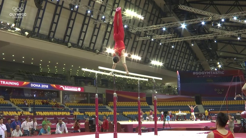 Xiao Ruoteng on parallel bars during training at the 2018 World Gymnastics Championships