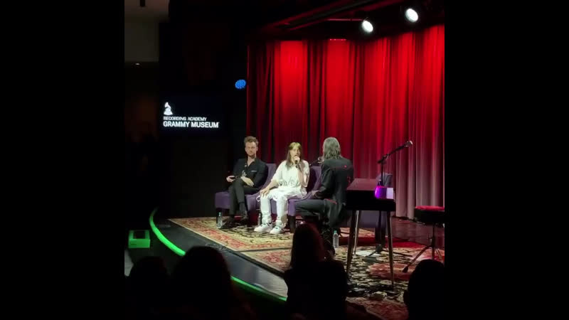Billie and finneas speaking on stage at the GRAMMY Museum in los angeles